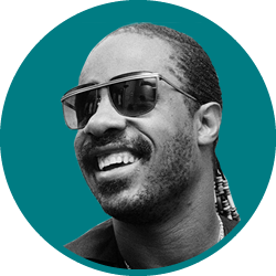 Picture of Stevie Wonder on a blue round background